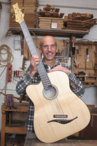 Christian Stoll with left-handed acoustic bass 5 string with Fanned Frets