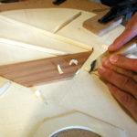 Bracing: The bracing is being carved.