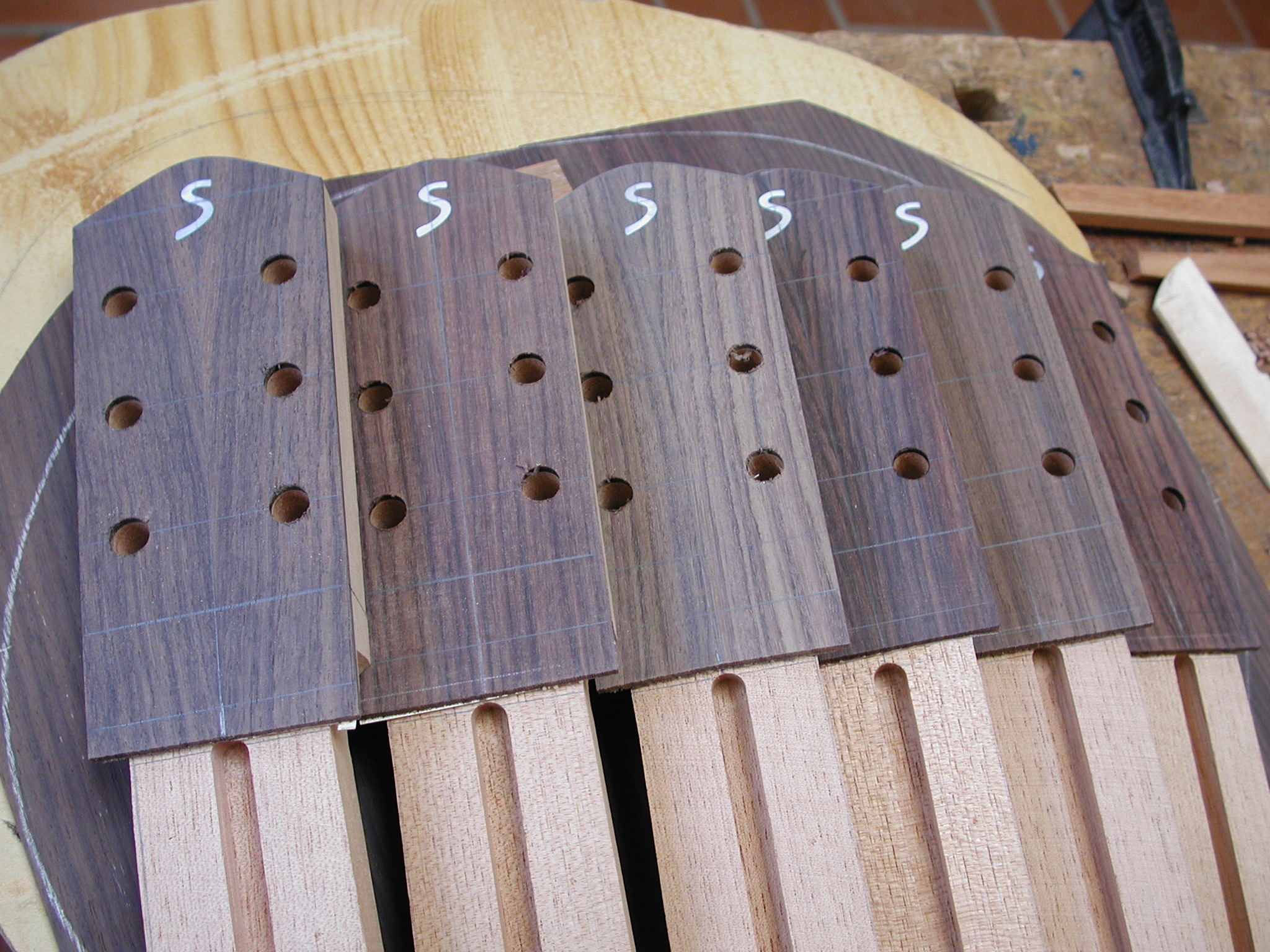 Headstock: glued in...and fits.