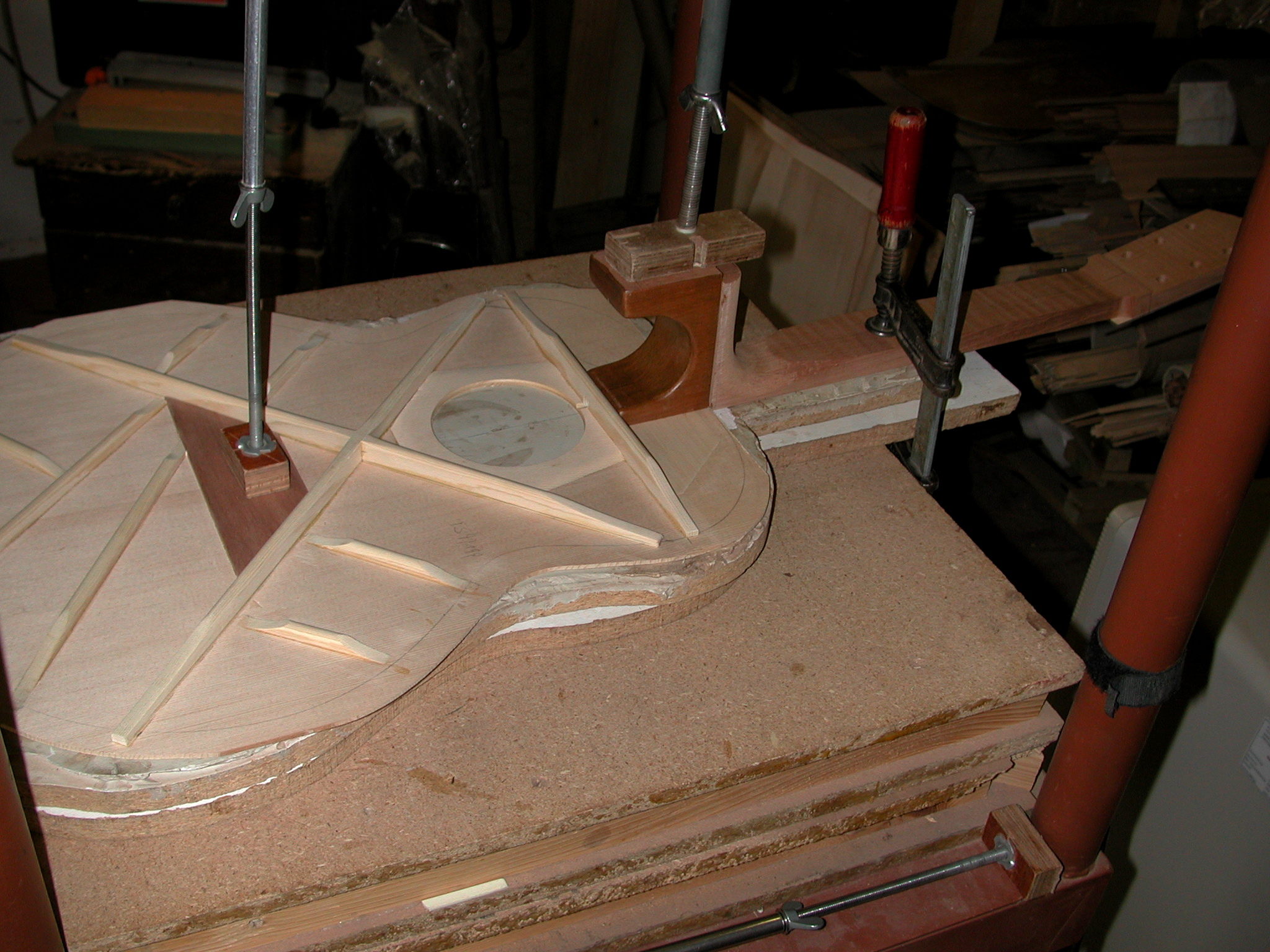 Top: The neck is glued to the top. Meanwhile, a finish has been applied to the part of the heel which sits inside the guitar.