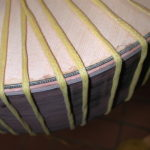 Bindings: After the binding is glued, it is held in place with ropes while it dries.