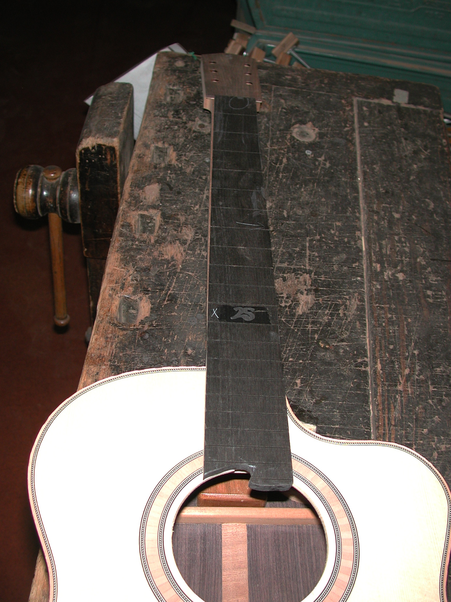 Fingerboard: The fingerboard is applied to the neck.