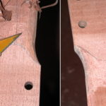 Neck: The transition area from the peghead to the back of the neck is carved.