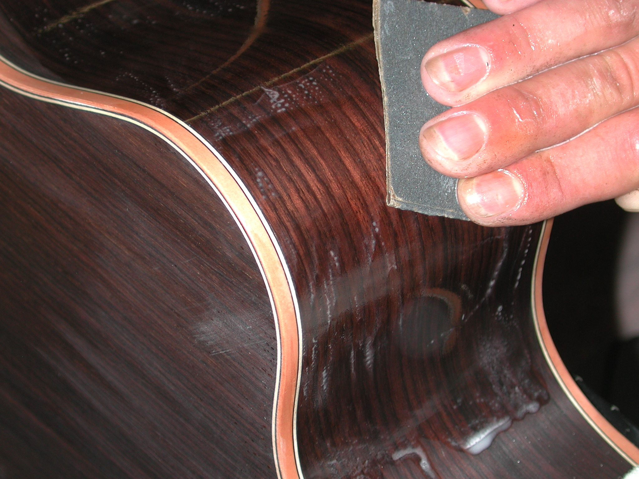 Finishing: Each layer of NC lacquer (10 layers) is sanded after drying.