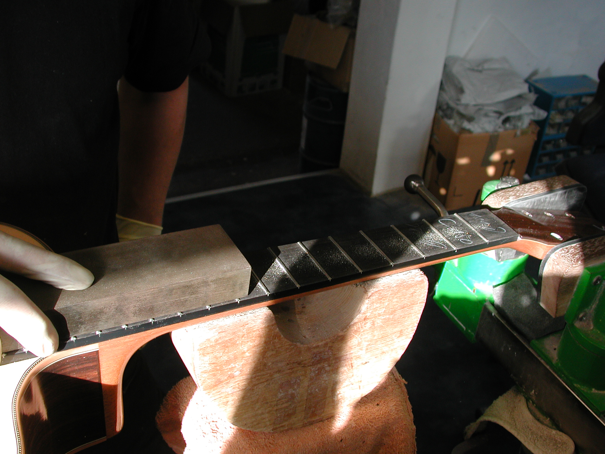 Fingerboard: The frets are levelled.