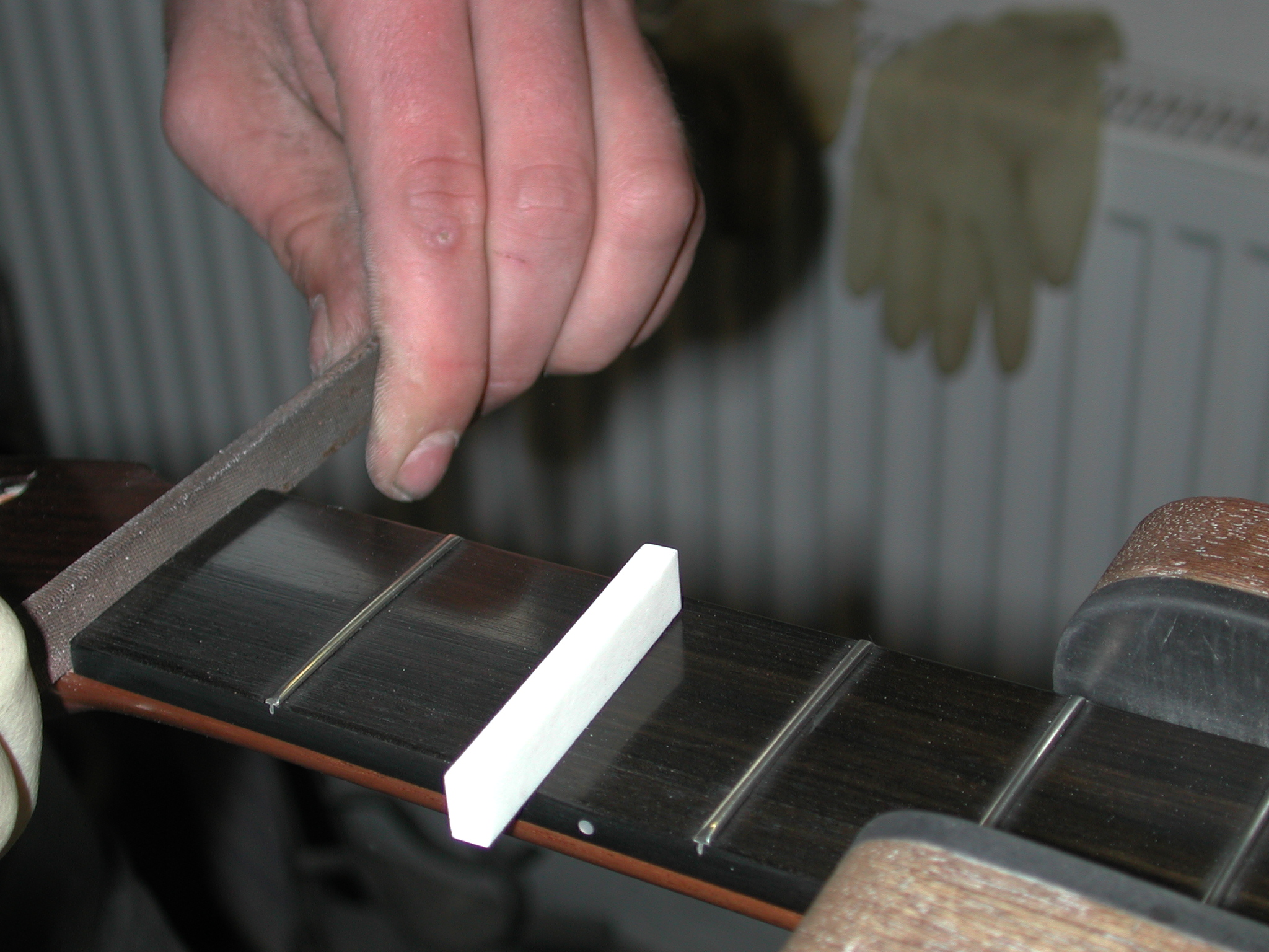 Fingerboard: The slot for the top nut is prepared.