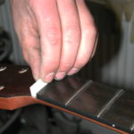 Fingerboard: The top nut is applied...
