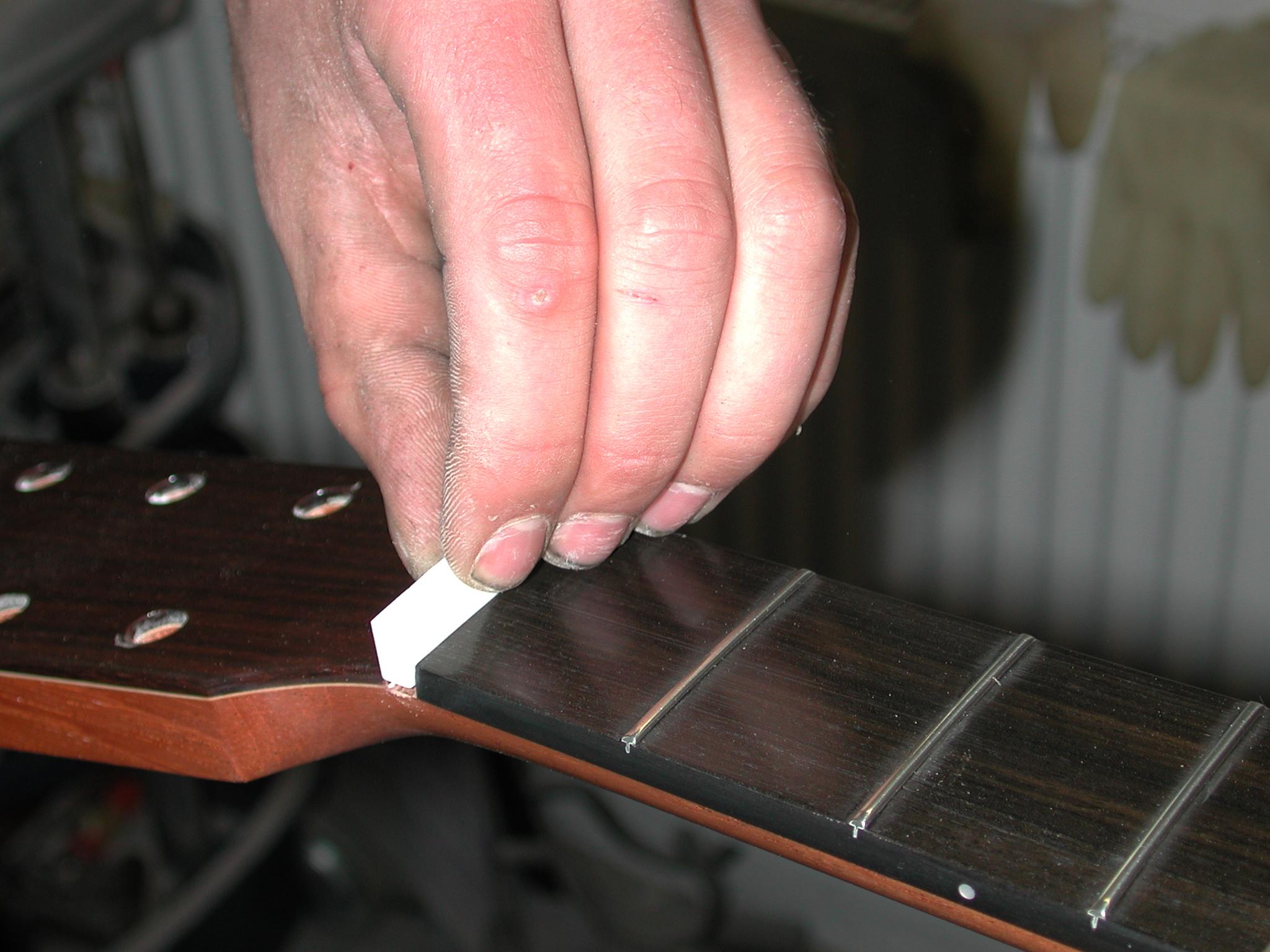 Fingerboard: The top nut is applied...