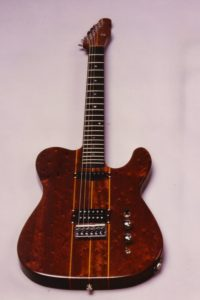 1984: Custom Built E-Guitar made from bird's-eye mahogany with neck through body, built in the shape of a famous American original