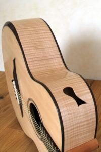 Jumbo Steel String Guitar with Extreme Cutaway, Fanned Frets, Armrest and Side Soundhole