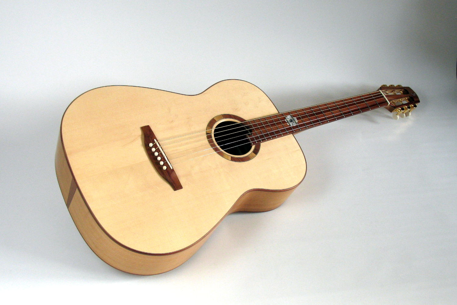 local wood steel string ambition fingerstyle cherry spruce plum stoll guitars. Black Bedroom Furniture Sets. Home Design Ideas